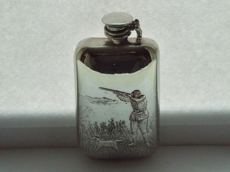Stamped Pewter Flask with Embossed Shooting Scene and Captive Top
